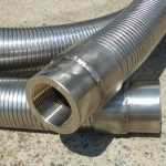 Flexible metal cryogenic transfer hose assembly complete with interlocked abrasion and diffusion armour