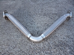 V loop hose expansion joint for earthquakes