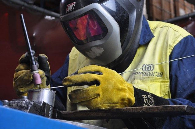 Our TIG welder manufacturing a stainless steel braided hose assembly