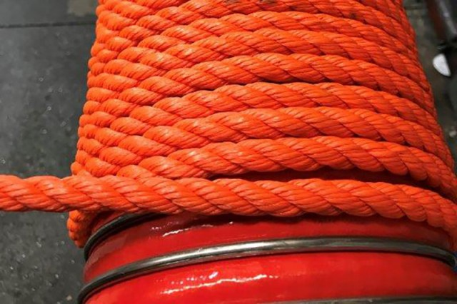 """Rope lagging of a 6"""" chemical composite dock hose."""