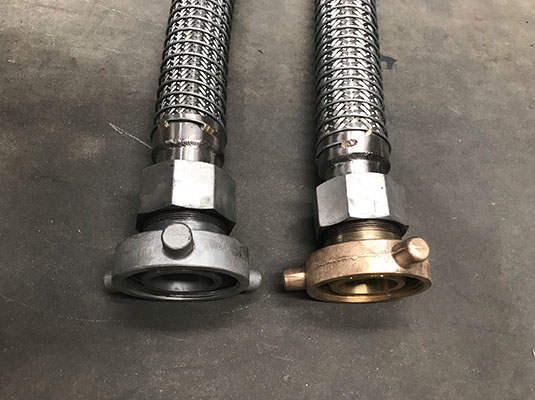 Aluminium and Bronze AS2475 end connections on metal braided transfer hose assembly with positive locking cone lock